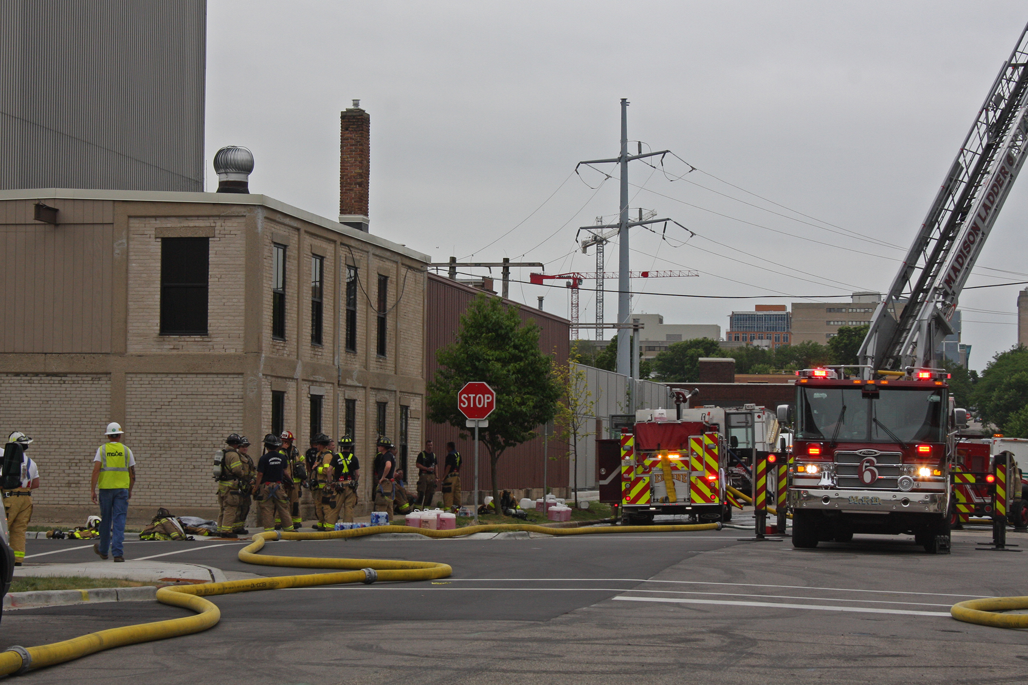 Madison firefighters and Madison Gas and Electric staff after a fire was put out