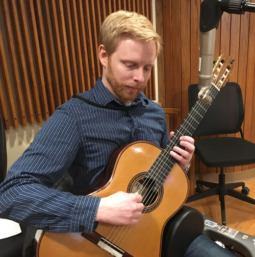 Photo of guitarist Miles McConnell in WPR Studio