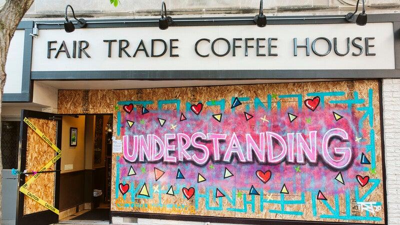 Madison street artist, Triangulador's artwork is displayed on Fair Trade Coffee House
