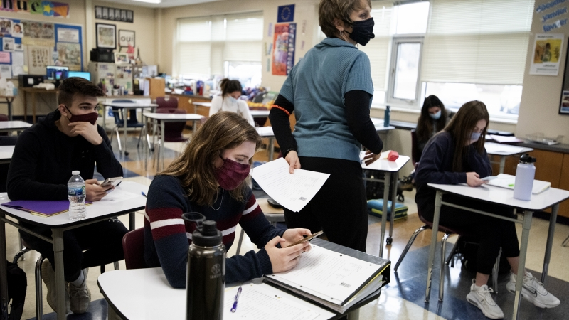 Students wear face masks during class