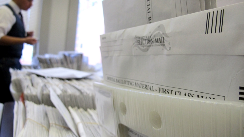 Milwaukee Election Commission staffer sorts absentee ballots