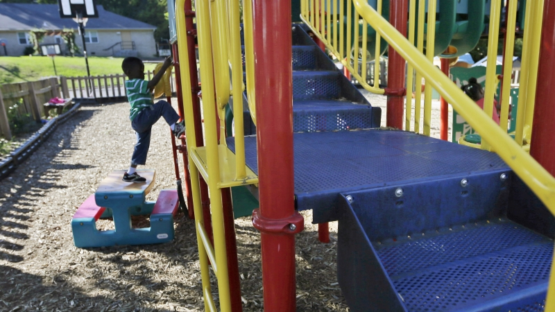 child playing on playground at child care facility