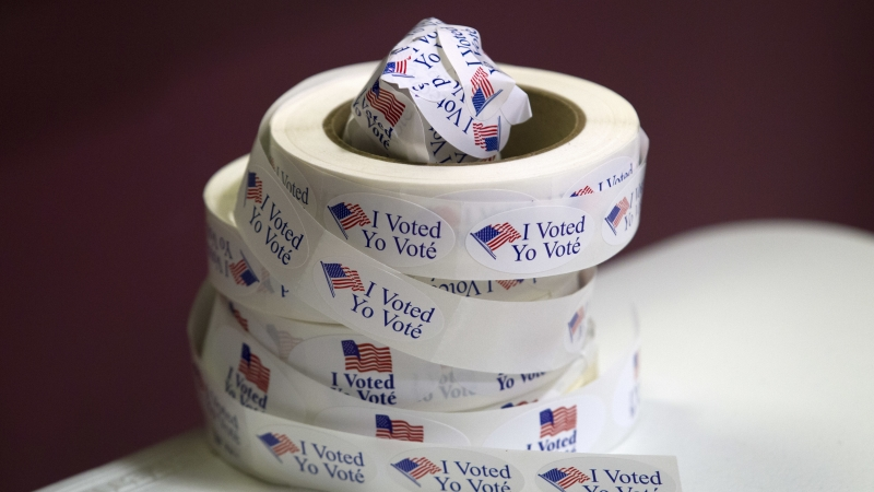 """I Voted"" stickers are seen at polling place"