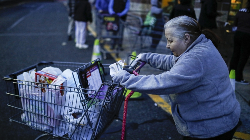 Customers leave a supermarket that opened special morning hours to serve people 60-years and older due to coronavirus concerns