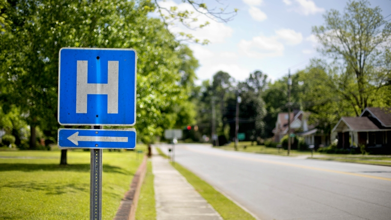 a sign points the way to Flint River Hospital