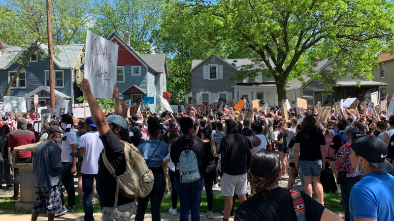 Protesters gather outside house where Tony Robinson was killed