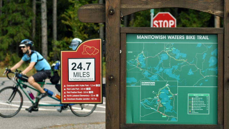 People Ride Bikes On Paved Trails In Vilas County