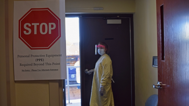 Kelly Groth, anurseat Mayo Clinic in La Crosse,headsout to the clinic's drive-thru COVID-19 testing station