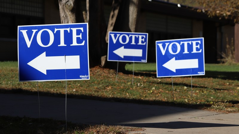 Signs telling voters where to enter the Mendota Elementary School polling place on Madison's north side