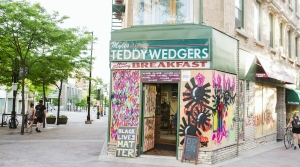 Triangulador's artwork is displayed on boarded up store windows on State Street