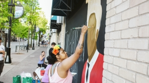 Artist Sirena Flores paints a tribute to Madison teenager Tony Robinson