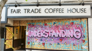 Madison street artist, Triangulador's artwork is displayed on Fair Trade Coffee House