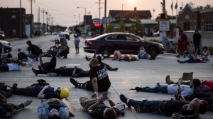 Protesters lie in the middle of the road
