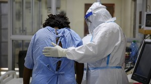 A medical worker attends to a coronavirus patient in the intensive care unit