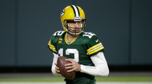 Green Bay Packers' Aaron Rodgers drops back during the second half of an NFL football game