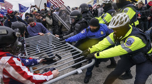 Trump supporters try to break through a police barrier