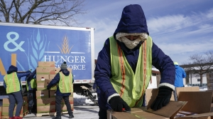 Hunger Task Force Workers distribute food at McGovern Park in Milwaukee