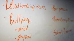 white board shows key words educating students about mental health