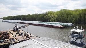 barges loaded with soy beans, potash or scrap steel await movement on the Mississippi River