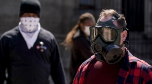 Voters in gas mask, bandana