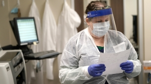 Julie Janke looks over test results from a COVID-19 antibody test