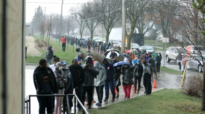 Voters stand in a long line in the pouring rain outside Marshall High School in Milwaukee