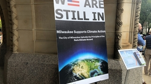 """A sign outside Milwaukee City Hall reads, """"We are still in. Milwaukee supports climate action."""""""
