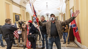 supporters of President Donald Trump are confronted by U.S. Capitol Police officers outside the Senate Chamber