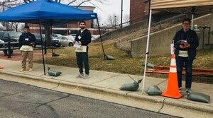 Poll workers provide curbside voting in Beloit, Wisconsin.