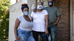 Robert, Stephanie Pettigrew and Heavenly are seen outside of their two-bedroom apartment in Milwaukee