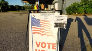 "A sign at a polling place on the northside of Madison also contains information about social distancing and a ""health alert"""
