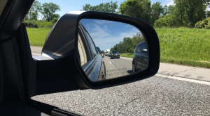 View of traffic on I-94 in side mirror