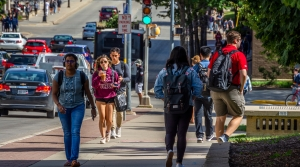 Students walking along Johnson St. on the University of Wisconsin-Madison campus.