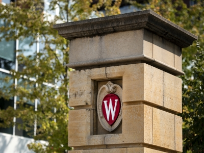 """A red """"W"""" logo is seen on a column on UW-Madison's campus"""