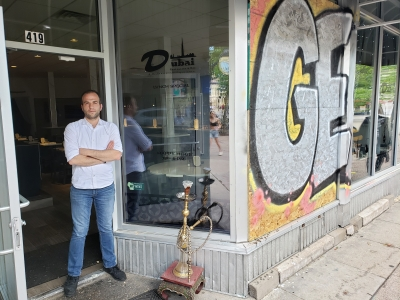 Dubai Restaurant and Bar owner Miar Maktabi removed most of the plywood from his storefront on Thursday, June 11.
