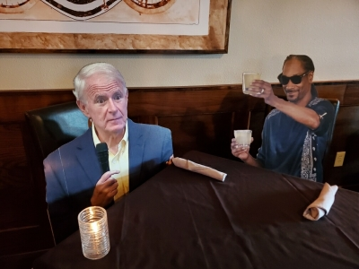 Cardboard cutouts of well-known figures are used to ensure spacing between patrons at Milwaukee Steakhouse.