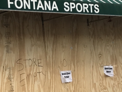 Signs supporting the Black Lives Matter movement are posted on downtown Madison storefronts