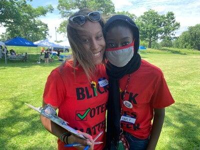 Members of Memorial High School's Black Student Union register people to vote