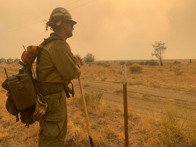 firefighters scout for safety routes and monitor fire behavior