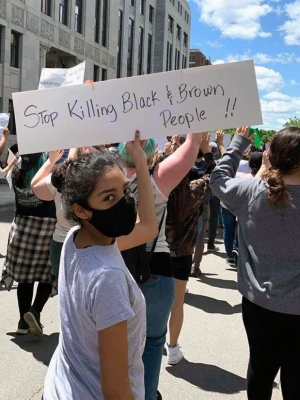Lynn Lee's daughter wears a mask during a Madison protest against police violence