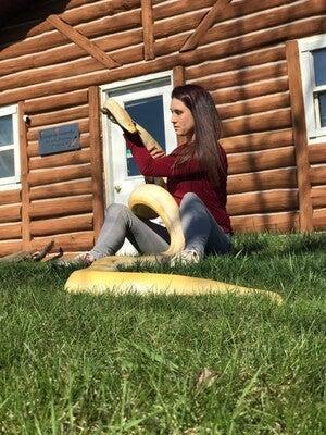 Jamie Kozloski with her Burmese python Butterscotch
