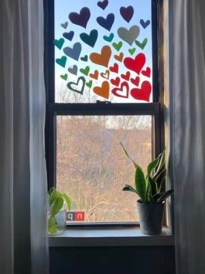 Hearts adorn a window decorated for the Happy Heart Hunt