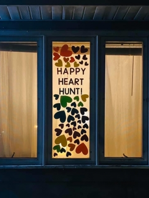 Leslie Brissette's daughter, Allyson Brissette, advertises the Happy Heart Hunt on one of the windows at her home in Beloit