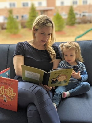 Beth Fogarty reads to her daughter Hazel.