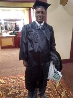 Charles Sheppard poses at his graduation