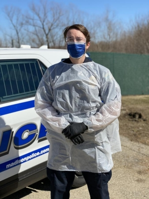 A police officer wearing personal protective equipment.
