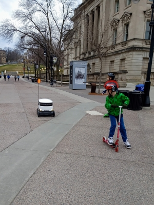 Anna Mullen took her son, Ryan, to see the food delivery robots near the UW-Madison library during the second week of Safer at Home.
