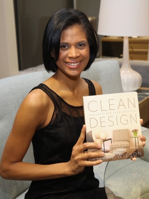 """Robin Wilson poses with her book, """"Clean Design: Wellness for your Lifestyle."""""""