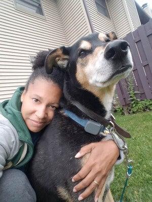 Shalicia Johnson cuddles her pet dog, Arrow