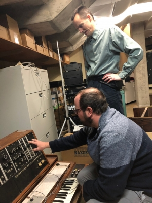 Nigel O'Shea inspects the UW-Madison Mead Witter School of Music's Moog synthesizer with Brian Heller.